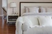 Luxury grey sofa on carpet in luxury bedroom  — Stock Photo