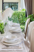 Table set in white dinning room — Foto Stock