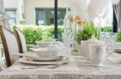 Table set in white dinning room — Stock Photo