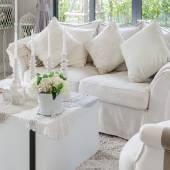Flower in vase on white table in living room  — Stock Photo