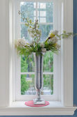 Vase of flower with window frame — Stock Photo