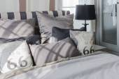 Grey pillows on bed in modern bedroom — Stock Photo