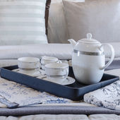 Tea cup set on black tray in bedroom  — Stock Photo