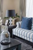 Blue pillows on sofa with black lamp in living room — Foto de Stock