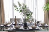 White modern dinning room with flower on table — Stock Photo