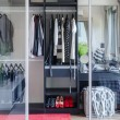 Closet with glass partition in bedroom — Stock Photo #67737411