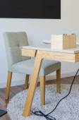 Modern wooden working desk with chair on carpet  — Stock Photo