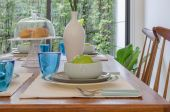 Table set on wooden trable in modern dinning room  — Stock Photo
