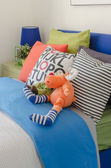 Pillows on blue sofa with lamp — Stockfoto