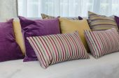 Group of colorful pillows on sofa in living room — Stock Photo