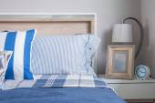 Blue color tone of kid's bedroom with alarm clock and lamp — Stock Photo