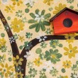 Close up tree art painting and bird house on cement. — Stock Photo #65850861