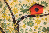 Close up tree art painting and bird house on cement. — Stock Photo