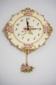 Vintage wall clock on white wall. — Stock Photo