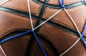 Close up old basketball ball in a net. — Stock Photo