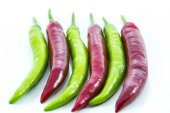 Contrast green switched red chili pepper — Stock Photo