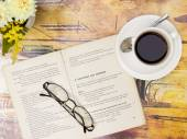 Reading book with cup of coffee — Stock Photo