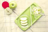 Apple juice on table mat — Stock Photo