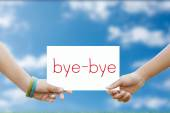 Two hand holds a sign for the bye-bye — Stock Photo