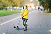 Boy with scooter — Stock Photo
