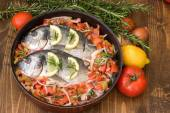 Sea fish with vegetables before baking. — Stock Photo