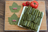 Grape leaves stuffed with rice and meat. — Stock Photo