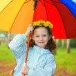 Little girl with a rainbow umbrella — Stock Photo #61448549