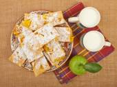 Homemade cake orange apple charlotte on tablecloths and canvas w — Stock Photo