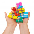 Many colored gift boxes in hands isolated on white background — Stock Photo #63448395