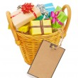 Many colored gift boxes in a basket isolated on white background — Stock Photo #63448509