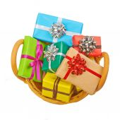 Many colored gift boxes in a basket isolated on white background — Stock Photo