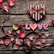 Word Love with heart shaped gift box — Stock Photo #61991259