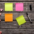 Different color sticky notes on wood table. — Stock Photo #61991315