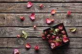 Rose petals inside open gift box. — Stok fotoğraf