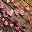 Word Love with rose petals — Stock Photo #63051755