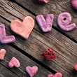 Word Love with rose petals — Stock Photo #63053441