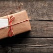 Vintage gift box with blank gift tag — Stock Photo #63054917