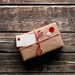 Vintage gift box with blank gift tag — Stock Photo #63052571