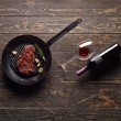 Marbled beef steak with a bottle of wine — Stock Photo #63052967