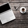 Laptop with coffee cup and pen — Stock Photo #63053619