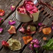 Background with gift box with rose petals — Stock Photo #63053691
