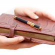 Woman hold diary in hands — Stock Photo #63053865