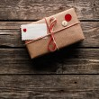 Vintage gift box with blank gift tag — Stock Photo #63055543