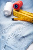 Needle with thread and tape measure — Stock Photo