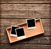 Instant photo frames on wooden box — Stock fotografie