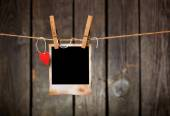 Blank instant photo and paper heart — Stock Photo