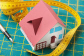 Toy house on graph background — Stock Photo