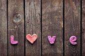 Word Love on vintage wood plates — Stock Photo