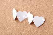 Paper hearts in chain with white pin — Stock Photo