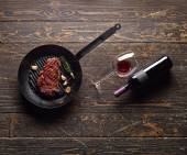 Marbled beef steak with a bottle of wine — Stockfoto